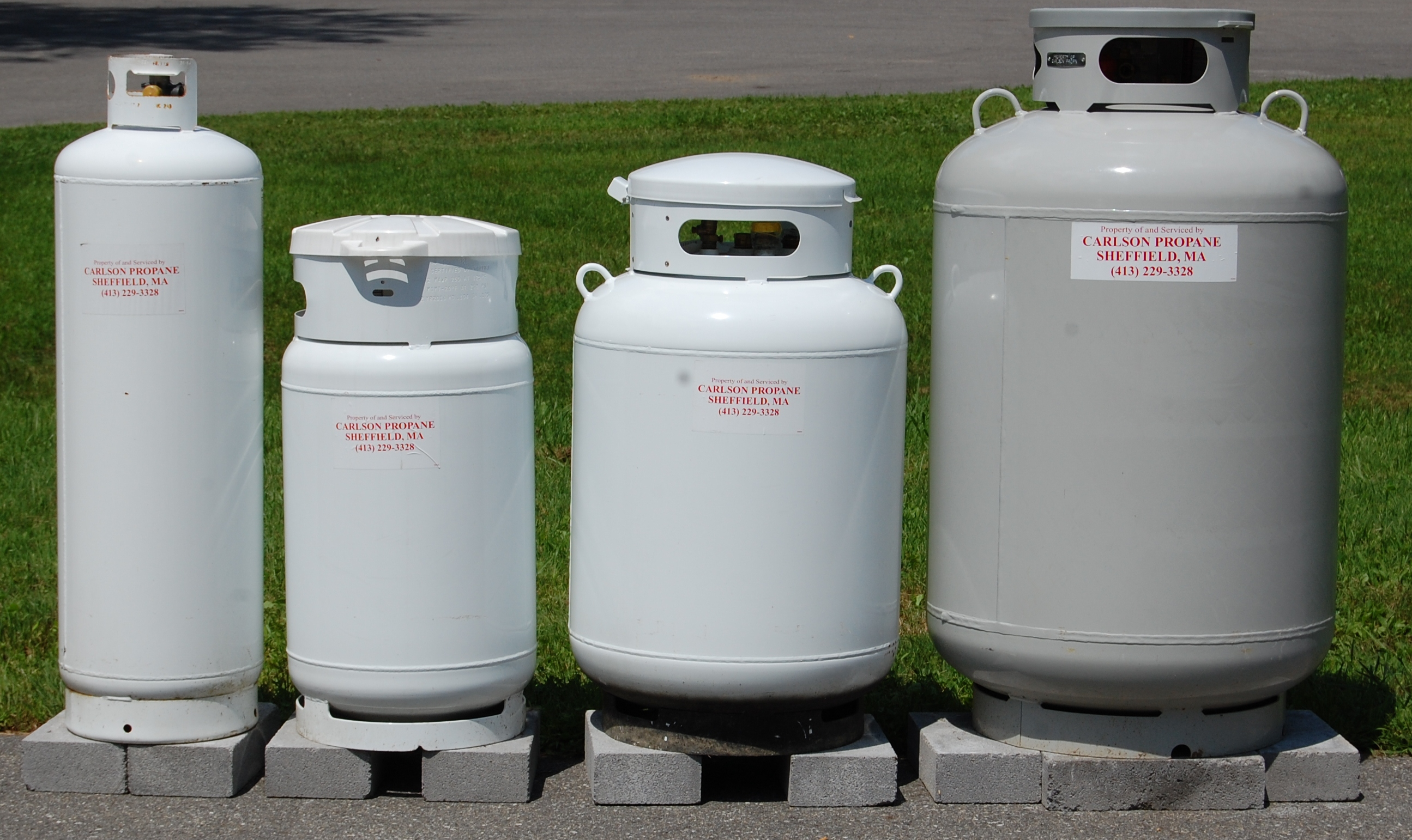 From left to right – 100# tank, capacity 23 gallons